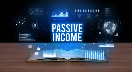 PASSIVE INCOME inscription coming out from an open book, creative business concept