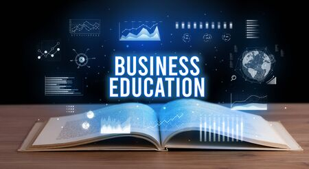 BUSINESS EDUCATION inscription coming out from an open book, creative business concept