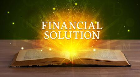 FINANCIAL SOLUTION inscription coming out from an open book, educational concept Foto de archivo - 132042130
