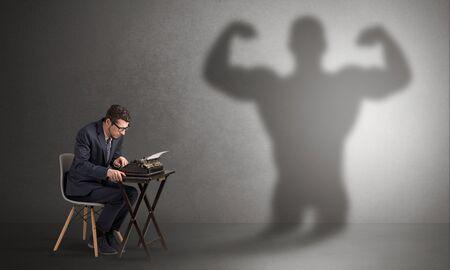 Little hard worker afraid of scary monster shadow Reklamní fotografie