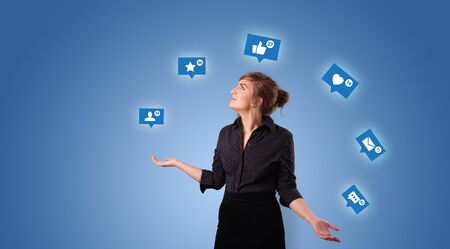 Young person playing with social media symbols Stock Photo