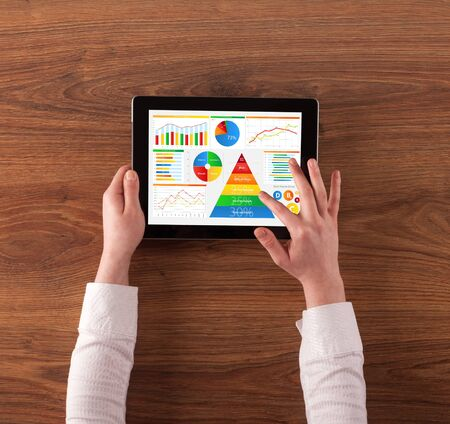 Business hand with tablet making analyses and checking the daily calories