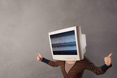 Young person with monitor head with no channel concept Imagens