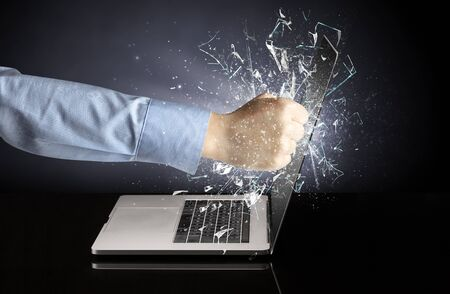 Hand hitting strongly laptop screen glass