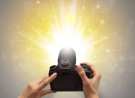 Naked hand taking picture with digital camera and glowing flash concept 스톡 콘텐츠