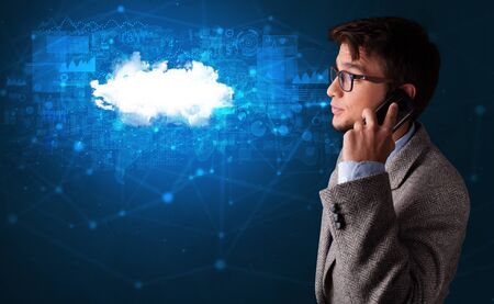 Person talking on the phone with blue cloud technology concept 스톡 콘텐츠
