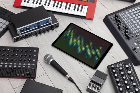 Recording music with tablet and electronic music instruments Stok Fotoğraf - 132189966