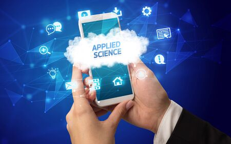 Female hand holding smartphone with APPLIED SCIENCE inscription, cloud technology concept