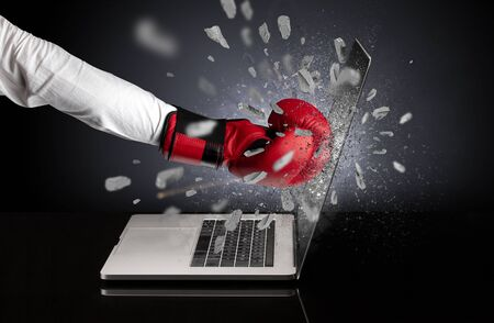 Strong male hand breaks laptop screen Stock Photo
