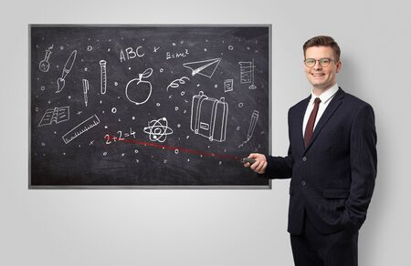 Handsome young teacher with laser pointer teaching Reklamní fotografie