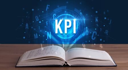 KPI inscription coming out from an open book, digital technology concept