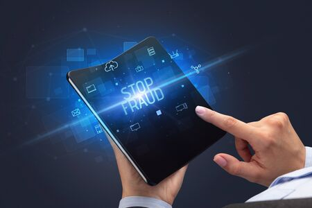 Businessman holding a foldable smartphone with STOP FRAUD inscription, cyber security concept
