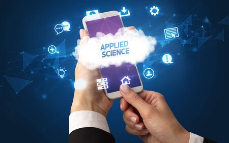 Female hand holding smartphone with APPLIED SCIENCE inscription, cloud technology concept Stock fotó