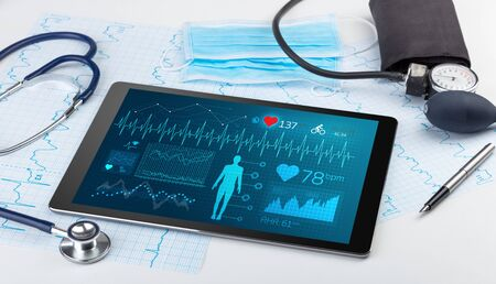 Live medical screening with medical application on tablet  Stock Photo