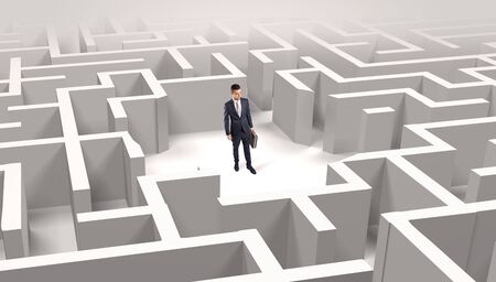 Young businessman standing in a middle of a 3D maze