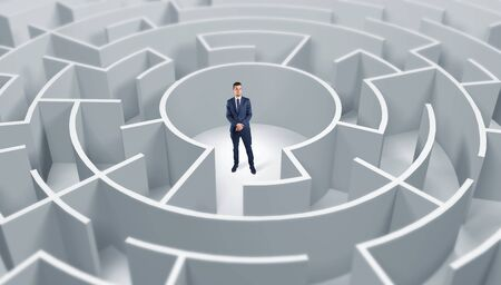 Young businessman standing in a middle of a 3d round maze Banco de Imagens