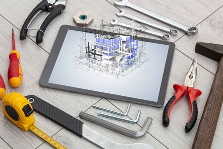 Tablet with construction tools and 3d house plan concept Stock Photo