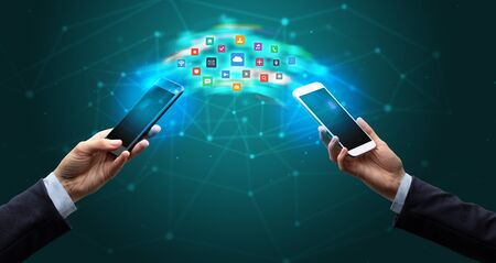 Two mobile phones syncing applications concept