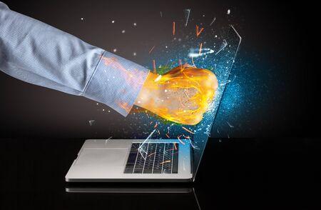 Firing hand hitting strongly laptop screen glass