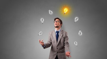 Young business person juggle with new idea concept Stok Fotoğraf