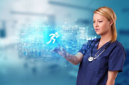 Doctor touching hologram screen displaying healthcare running symbols Stock Photo