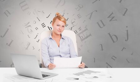 Business person sitting at desk with editorial and letters concept Reklamní fotografie - 133080488