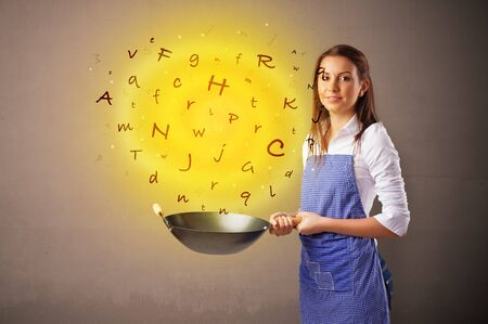 Young person cooking letters in wok Reklamní fotografie - 133388300
