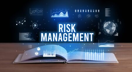 RISK MANAGEMENT inscription coming out from an open book, creative business concept