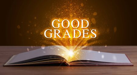 GOOD GRADES inscription coming out from an open book, educational concept