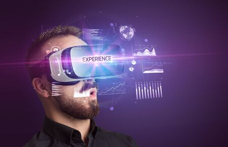 Businessman looking through Virtual Reality glasses with EXPERIENCE inscription, new business concept