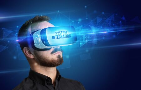 Businessman looking through Virtual Reality glasses with SYSTEM INTEGRATION inscription, cyber security concept