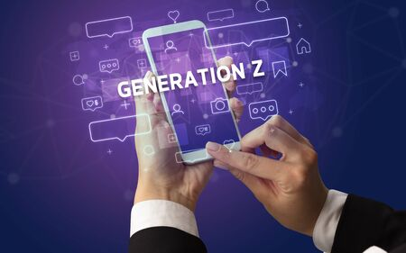 Female hand typing on smartphone with GENERATION Z inscription, social media concept