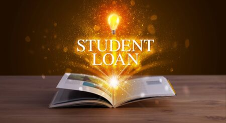 STUDENT LOAN inscription coming out from an open book, educational concept