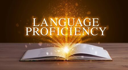 LANGUAGE PROFICIENCY inscription coming out from an open book, educational concept Stock fotó