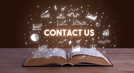 CONTACT US inscription coming out from an open book, business concept Stock fotó