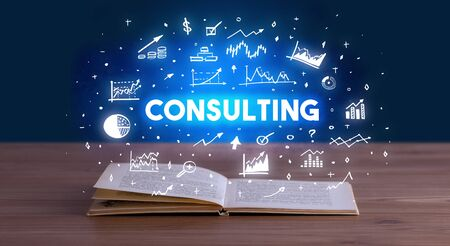 CONSULTING inscription coming out from an open book, business concept Stock fotó