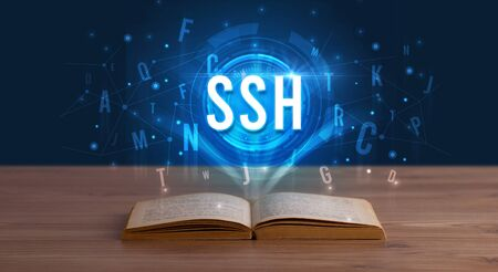 SSH inscription coming out from an open book, digital technology concept Stock fotó - 133388662