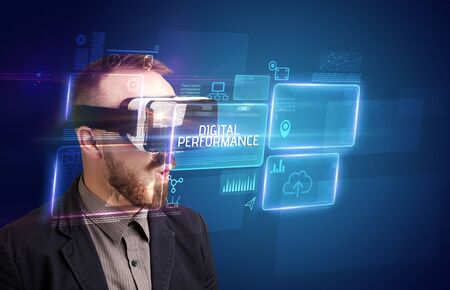 Businessman looking through Virtual Reality glasses with DIGITAL PERFORMANCE inscription, new technology concept Stok Fotoğraf