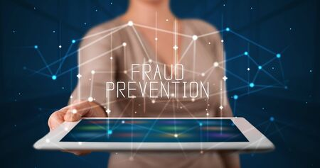 Young business person working on tablet and shows the digital sign: FRAUD PREVENTION Stock fotó - 133388691