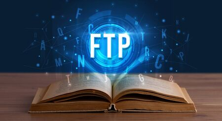 FTP inscription coming out from an open book, digital technology concept