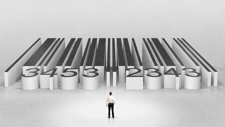 Young businessman standing in front of a big codebar