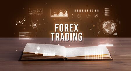 FOREX TRADING inscription coming out from an open book, creative business concept 写真素材