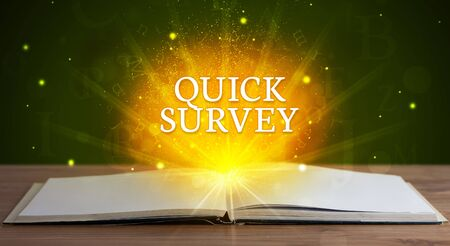 QUICK SURVEY inscription coming out from an open book, educational concept 写真素材