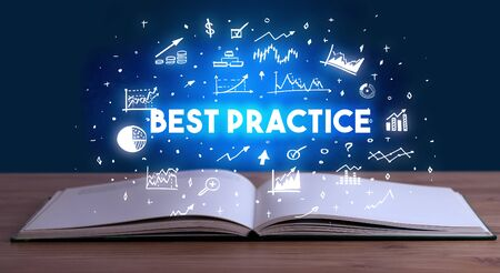 BEST PRACTICE inscription coming out from an open book, business concept 写真素材
