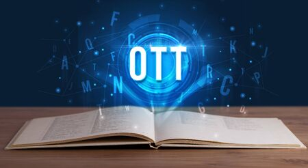 OTT inscription coming out from an open book, digital technology concept 写真素材