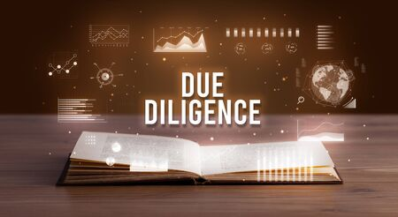 DUE DILIGENCE inscription coming out from an open book, creative business concept
