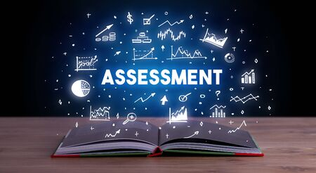 ASSESSMENT inscription coming out from an open book, business concept