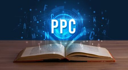 PPC inscription coming out from an open book, digital technology concept