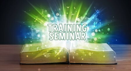 TRAINING SEMINAR inscription coming out from an open book, educational concept