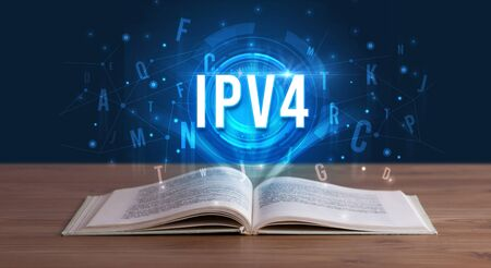 IPV4 inscription coming out from an open book, digital technology concept 写真素材